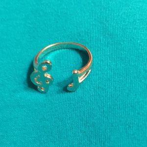 Music note treble clef adjustable ring.